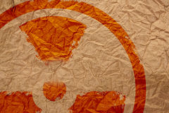 Sign. Nuclear symbol on crumpled paper Royalty Free Stock Photography