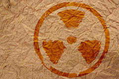 Sign. Nuclear symbol on crumpled paper Royalty Free Stock Image