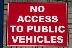 Sign. Red backed sign with 'NO ACCESS TO PUBLIC VEHICLES' in white letters and a white border Royalty Free Stock Photos