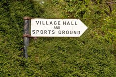 A sign. A village hall sign against vegetation Stock Image