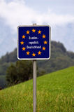 Sign. Indicating the border crossing to Germany in the Alps between Austria and Germany Royalty Free Stock Image