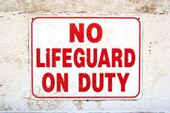 Sign. Saying No Lifeguard on Duty Stock Photography