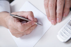 Sign. Businessman's hand  with pan Royalty Free Stock Images