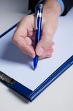 Sign. Businessman's hand  with pen Royalty Free Stock Image