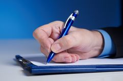 Sign. Businessman's hand  with pen Royalty Free Stock Photography