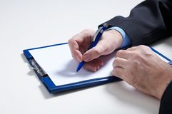 Sign. Businessman's hand  with pan Stock Photo