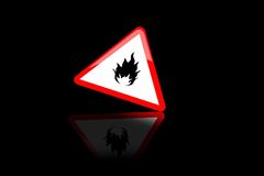 Sign. On black background in red triangle sign fire Royalty Free Stock Images