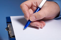 Sign. Businessman's hand  with pen Stock Images