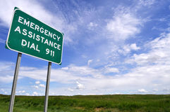 Sign for 911 number. Low-angle view of a sign reminding motorists of the emergency number 911 Royalty Free Stock Photos