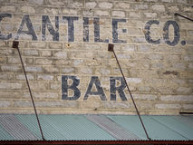 Sign above a business in rural Nevada. Mercantile company and bar in a rural Nevada town Royalty Free Stock Images