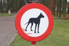 Sign access denied: no dogs and pets allowed. Prohibition sign in the forest: no dogs and pets allowed, Netherlands Royalty Free Stock Image