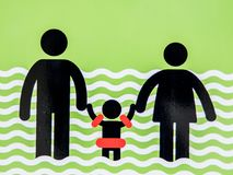 Sign adults keep looking to their kid. In water, safe way to swim royalty free stock photography