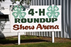 Sign advertising the 4-H show arena at a county fair royalty free stock photo