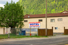 A sign advertising a hotel and restaurant at harrison hot springs in both english and japanese Royalty Free Stock Photo
