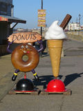 Sign. Advertising ice cream and doughnuts for sale on the promenade at Southsea Royalty Free Stock Photos
