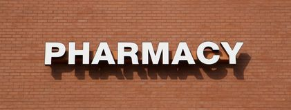 A sign advertising pharmacy services. Stock Photos