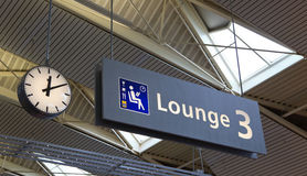 Sign for airline lounge. In Schiphol airport royalty free illustration