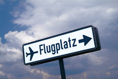 Sign airport. A blue marker airport with cloudy sky royalty free stock photos