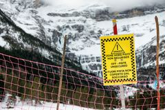 Sign alerts off-piste unsecured in french mountains. Sign alerts off-piste unsecured in the french mountains stock photography