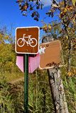 Sign allowing bicycling and riding horseback Royalty Free Stock Photos