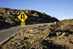 Sign along a curve in a road. stock images