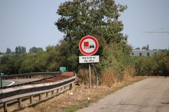 Sign along motorway A20 for permit to catch up for trucks during daytime and shoulder. Sign along motorway A20 for permit to catch up for trucks during daytime royalty free stock images