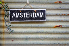 Sign Amsterdam hanging on the hole Royalty Free Stock Photos