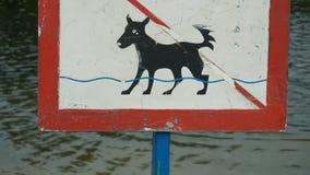 A sign an animal is forbidden to bathe.  Stock Photos