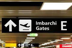 Sign arrow direction at airport indicating Gates. Sign arrow direction at airport indicating Imbarchi translation Gates Royalty Free Stock Photos