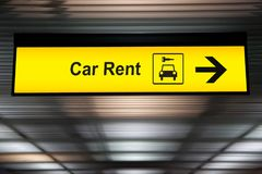Sign with arrow point to rent a car service at the airport. For passenger who want to hide a car for travel around city. freedom transportation for convenient royalty free stock photo