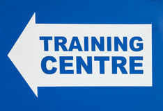 Sign with Arrow Pointing Left Stating TRAINING CENTRE Stock Photography