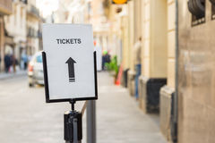 Sign and arrow for tickets on a street Royalty Free Stock Photos