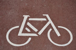 Sign on asphalt - bicycle path. Traffic sign on asphalt bike path in the city Royalty Free Stock Photography