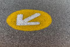 A sign on asphalt stock photos