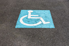 Sign on the asphalt parking for disabled Royalty Free Stock Photo