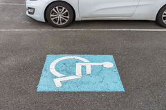 Sign on the asphalt parking for disabled Stock Photography