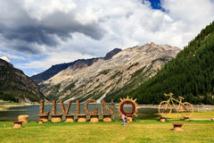 Free Sign At Village Of Livigno Near Alpine Lake Stock Photography - 58767432