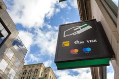 Sign on an ATM with the logos indicating the credit and debit pay cards accepted stock photos