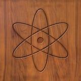 Sign atom on wood Stock Photo