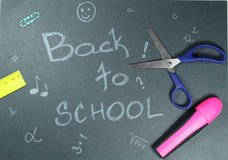 Sign ,,Back to school` on black background. This is notice ,,Back to school` on black background with school aids Stock Photos