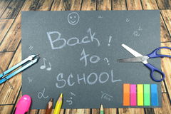 Sign ,,Back to school` on black background Stock Images