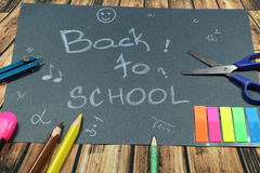 Sign ,,Back to school` on black background. This is notice ,,Back to school` on black background with school aids Stock Photography