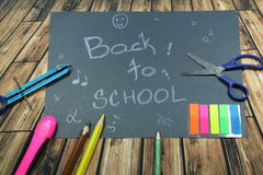 Sign ,,Back to school` on black background. This is notice ,,Back to school` on black background with school aids Royalty Free Stock Images