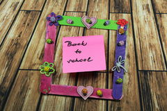 Sign ,,Back to school` in the photo frame Royalty Free Stock Photography