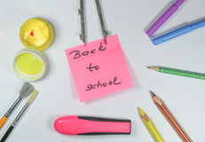 Sign ,,Back to school` on white background Stock Photos