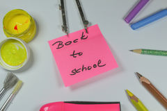 Sign ,,Back to school` on white background. This is notice ,,Back to school` on white background with school aids Stock Photography