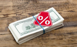 Sign %. On the background of one hundred dollar bills Stock Photo