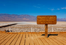 Sign Bad Water Basin and salt behind, Death Valley Stock Photo