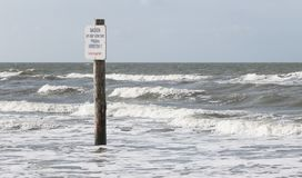 Sign `Baden forbidden` stands on the shore royalty free stock images