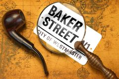 Sign BAKER STREET, Smoking Pipe, Magnifier On The OLD Map Royalty Free Stock Photography